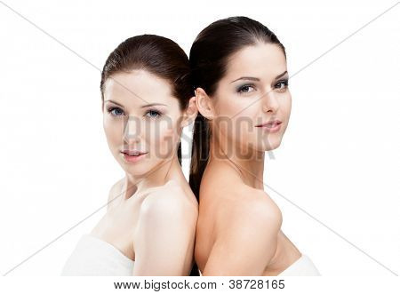 Half length portrait of two half naked women who are ready for beauty procedures, isolated on white