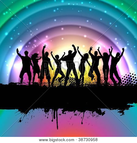 Silhouettes of people dancing on a rainbow background