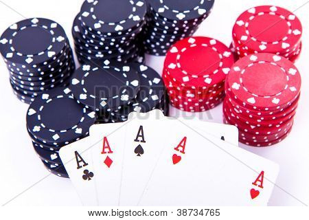 playing cards and poker chips on white background
