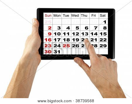 tablet computer isolated in a hand on the white backgrounds. like ipade pc, calendar December 2012