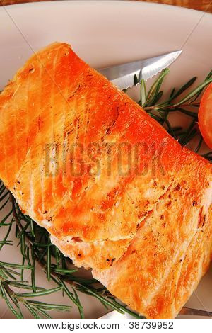 holiday dinner roast fish hot grilled salmon over glass plate on over wooden table