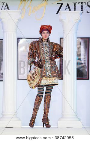 MOSCOW - NOVEMBER 4: Model in suit with ethnic pattern on show of designer Slava Zaitsev in fashion house of Slava Zaitsev on November 4, 2011 in Moscow, Russia.