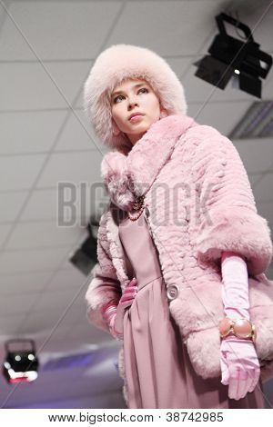 MOSCOW - NOVEMBER 4: Model in half-length coat in fashion house of Slava Zaitsev on November 4, 2011 in Moscow, Russia.