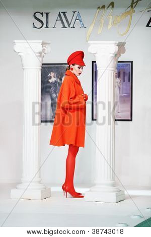 MOSCOW - NOVEMBER 4: Model in coat on show of designer Slava Zaitsev in fashion house of Slava Zaitsev on November 4, 2011 in Moscow, Russia.