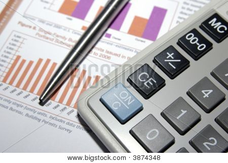 Calculator, Steel Pen And Financial Analysis Report.