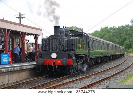 BODIAM, ENGLAND - AUGUST 20: USA 0-6-0T class steam locomotive on the Kent and East Sussex Railway on August 20, 2012 at Bodiam, Sussex. Built in the USA in 1943, it is now in Southern Railway livery.
