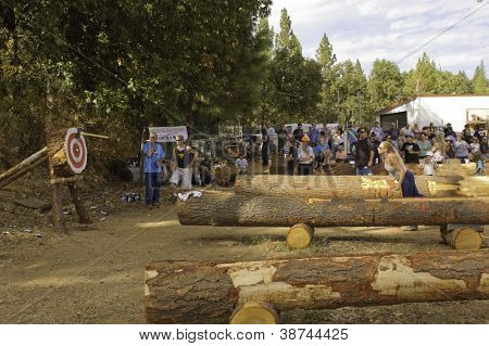 WEST POINT, CA - OCTOBER 6: Unidentified competitors in axe throwing event at the Lumberjack day, on October 6, 2012 in West Point. West Point celebrates it's 38th Lumberjack day.
