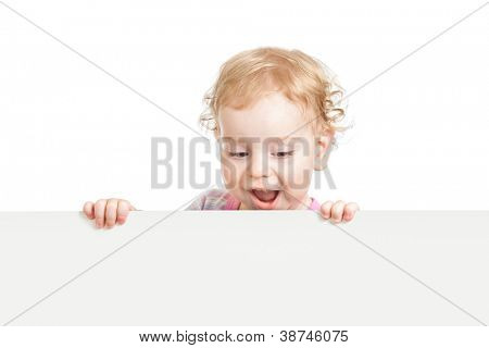 kid looking down behind white empty banner isolated