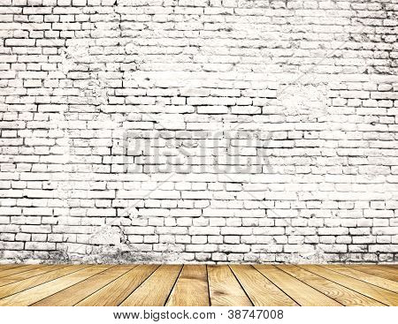 Old brick wall on wood floor