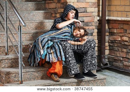Young hippie couple sitting on the steps