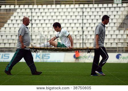 KAPOSVAR, HUNGARY - SEPTEMBER 29: Lukacs Bole (in white) injured at a Hungarian National Championship soccer game - Kaposvar (white) vs Eger (red) on September 29, 2012 in Kaposvar, Hungary.