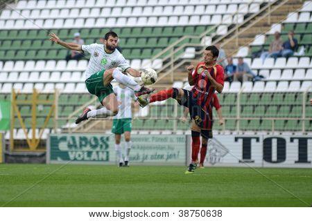 KAPOSVAR, HUNGARY - SEPTEMBER 29: Pedro Sass (in white) in action at a Hungarian National Championship soccer game - Kaposvar (white) vs Eger (red) on September 29, 2012 in Kaposvar, Hungary.