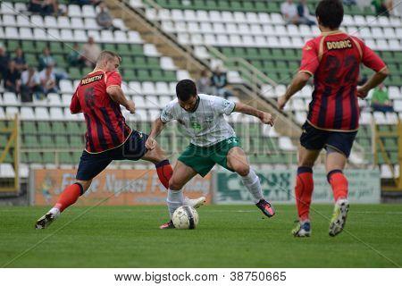KAPOSVAR, HUNGARY - SEPTEMBER 29: Pedro Sass (C) in action at a Hungarian National Championship soccer game - Kaposvar (white) vs Eger (red) on September 29, 2012 in Kaposvar, Hungary.