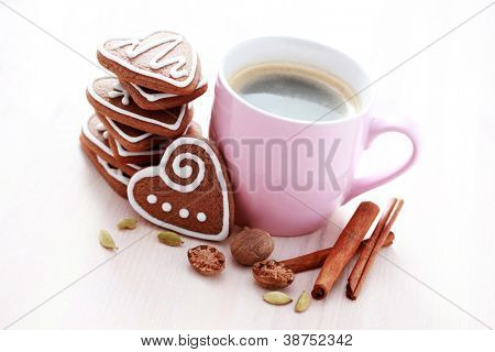 cup of coffee and delicious gingerbreads - sweet food