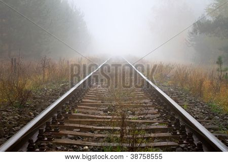 Train rails in foggy weather in Poland