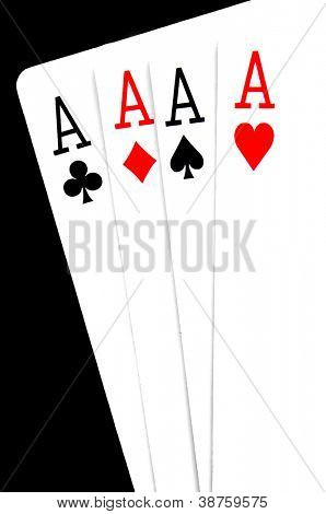 a hand of poker with four aces on a black background