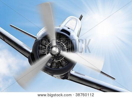 Vintage plane on a sunny sky. Retro technology background.