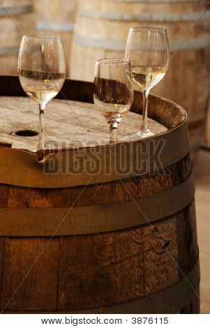 Wine Glasses On An Old Barrel