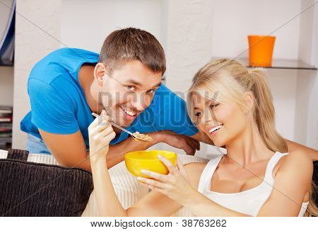 bright picture of happy couple with muesli (focus on woman)