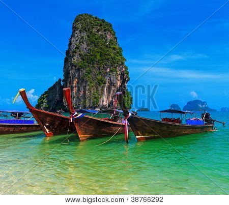 Travel background. Traditional long tail boats in azure sea near Pranang beach, Krabi, Thailand
