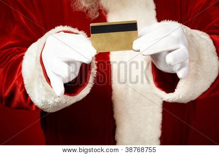 Photo of Santa Claus gloved hands holding credit card