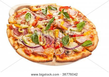 delicious ham, salami,  mushroom and vegetable pizza on a cutting board