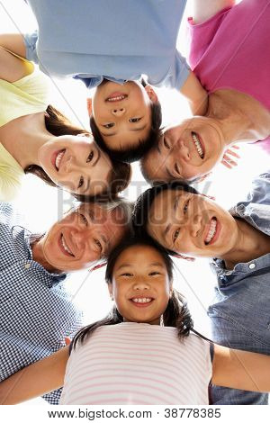 Portrait Of Multi-Generation Chinese Family Looking Down Into Camera