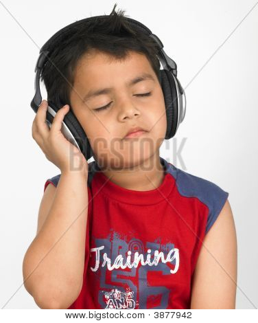 Asian Boy Of Indian Origin With Enjoying Music With Headphones