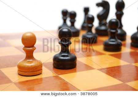 One White Pawn Fights Against Black Army On Chess Board.