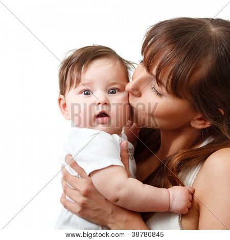 happy young mother kiss cute smiling baby, isolated on white