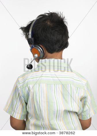Asian Boy Of Indian Origin With Headphones