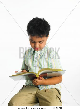 Asian Boy Of Indian Origin Reading A Book