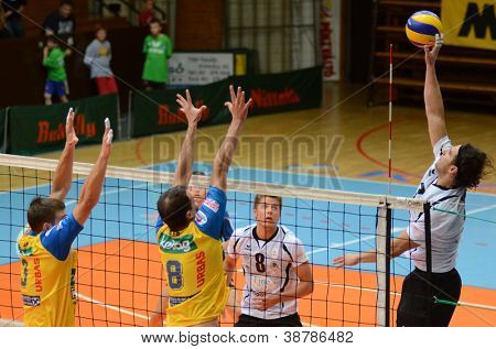 KAPOSVAR, HUNGARY - OCTOBER 5: Andras Geiger (R) in action at a Middle European League volleyball game Kaposvar HUN (w) vs Posojilnica AUT (y), October 5, 2012 in Kaposvar, Hungary
