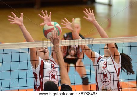 KAPOSVAR, HUNGARY - OCTOBER 7: Timea Kondor (L) in action at the Hungarian I. League volleyball game Kaposvar (white) vs Veszprem (black), october 7, 2012 in Kaposvar, Hungary.