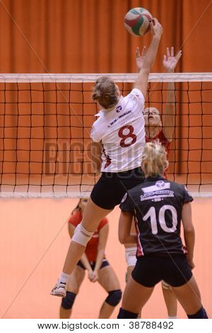 BUDAPEST, HUNGARY - OCTOBER 10: Timea Kondor (white 8) in action at the Hungarian I. League volleyball game Kaposvar (white) vs Budai XI (red), October 10, 2012 in Budapest, Hungary.