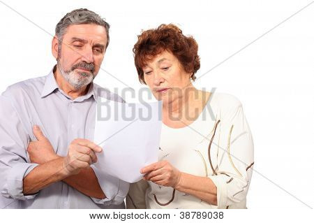 serious senior couple hold paper list in hands, isolated