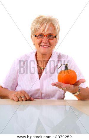 A Senior Woman With A Pumpkin