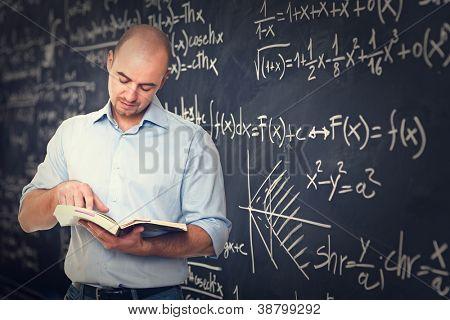 portrait of teacher and blackboard background