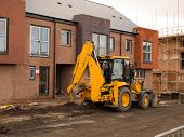 picture of jcb  - JCB Digger at Construction Site New Build Houses - JPG