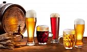 image of brew  - Beer barrel with beer glasses on a wooden table - JPG