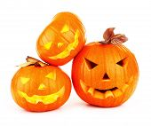 Image of halloween holiday background, three orange carved pumpkin isolated on white background, tra