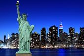 stock photo of statue liberty  - Manhattan Skyline and The Statue of Liberty at Night Lights - JPG