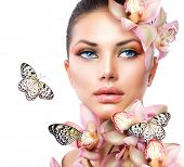 stock photo of butterfly  - Beautiful Girl With Orchid Flowers and Butterfly - JPG