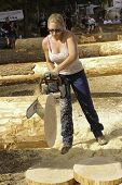 WEST POINT, CA-OCTOBER 6: Unidentified competitor in the woman's chainsaw event at Lumberjack day, o