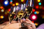 stock photo of champagne glasses  - Image of people hands with crystal glasses full of champagne - JPG