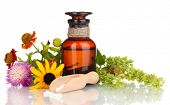 picture of mixture  - medicine bottle with tablets and flowers isolated on white - JPG
