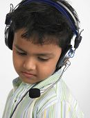Boy Of Indian Origin With Headphones Enjoying His Music