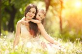 stock photo of cuddle  - Mother and daughter in the park - JPG