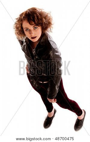 Portrait of a beautiful gothic woman in black leather jacket in a studio