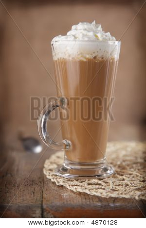 Coffee Latte With Whipped Cream In Rustic Style And Rough Vignette For Style